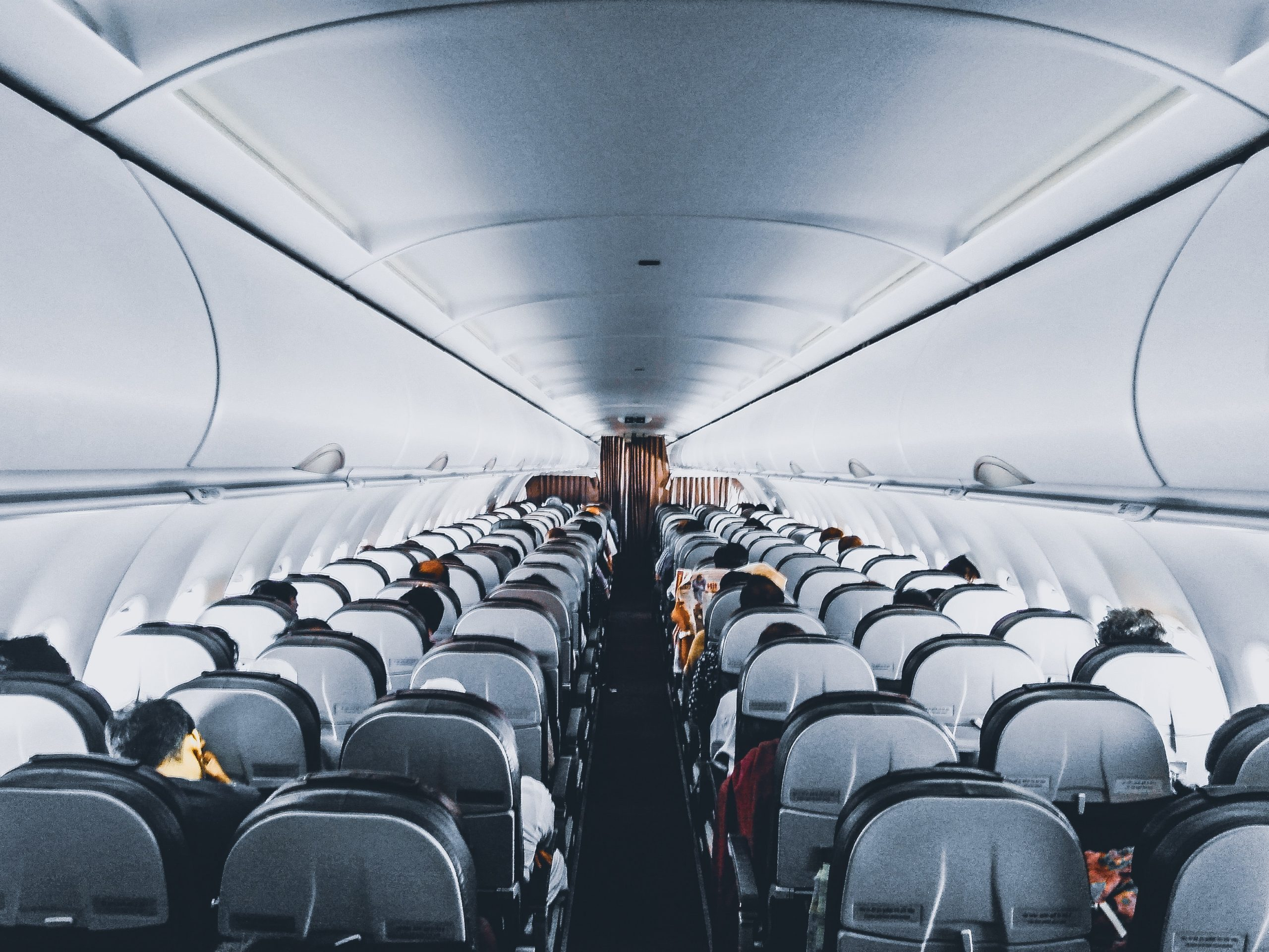 people-inside-commercial-air-plane-1309644-083660-jZh1ElVn-scaled